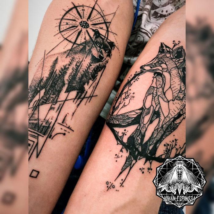 Tatuaje de lobos y bosque en antebrazos